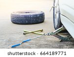 jacking up a car to change a... | Shutterstock . vector #664189771