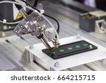 automation robot welding for... | Shutterstock . vector #664215715
