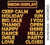 golden words with bulb lamps.... | Shutterstock .eps vector #664228021