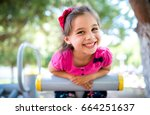 little girl playing at... | Shutterstock . vector #664251637