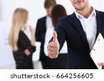 handsome smiling man showing ok ... | Shutterstock . vector #664256605