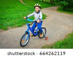 A Happy Child Rides Bicycle In...