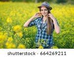attractive young blonde woman... | Shutterstock . vector #664269211