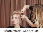 beautiful blonde girl with long ... | Shutterstock . vector #664275235