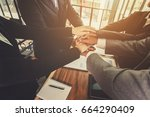 business team to cooperate in... | Shutterstock . vector #664290409