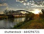 sunset bridge over danube tisa... | Shutterstock . vector #664296721