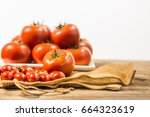 tomatoes on the table with...   Shutterstock . vector #664323619