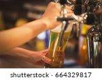 bartender pouring beer | Shutterstock . vector #664329817
