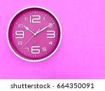 closeup a deep pink wall clock...   Shutterstock . vector #664350091
