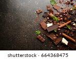 heap of broken chocolate pieces ... | Shutterstock . vector #664368475