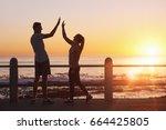 friends high five celebrating... | Shutterstock . vector #664425805