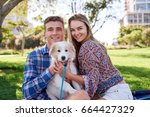 young loving couple smiling... | Shutterstock . vector #664427329