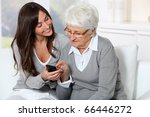 young woman showing how to use... | Shutterstock . vector #66446272