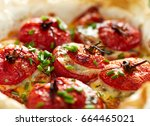 oven baked tomatoes stuffed... | Shutterstock . vector #664465021