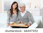 elderly woman and home carer... | Shutterstock . vector #66447352