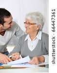 young man helping elderly woman ... | Shutterstock . vector #66447361