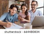 lovely schoolboy finishing up... | Shutterstock . vector #664480834