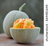 ripe cantaloupe melon on wooden ... | Shutterstock . vector #664481644