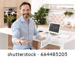 pleasant cheerful man holding a ... | Shutterstock . vector #664485205