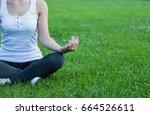 woman doing yoga outdoor. close ... | Shutterstock . vector #664526611