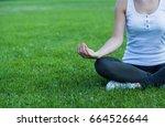 woman doing yoga outdoor. close ... | Shutterstock . vector #664526644