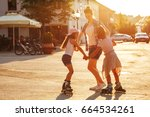 mother plays with her daughters ... | Shutterstock . vector #664534261