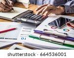 businessman calculating... | Shutterstock . vector #664536001