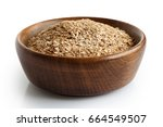 wheat bran in dark wooden bowl... | Shutterstock . vector #664549507
