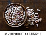 Dry Pinto Beans In Dark Wooden...