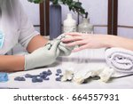 closeup finger nail care by... | Shutterstock . vector #664557931