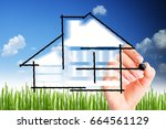 Small photo of House design or build your own house with woman hand drawing against blue sky