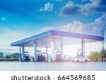 gas fuel station with clouds... | Shutterstock . vector #664569685