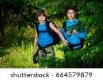 two boys friends go hiking with ...   Shutterstock . vector #664579879