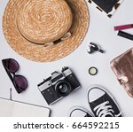 hat  camera and other woman's... | Shutterstock . vector #664592215