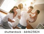 cheerful family playing... | Shutterstock . vector #664625824