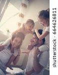 family spending free time at... | Shutterstock . vector #664626811