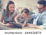 family lying on the floor with... | Shutterstock . vector #664626874
