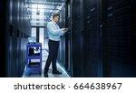 it engineer installing hard... | Shutterstock . vector #664638967