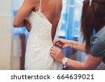 bride wears a wedding dress | Shutterstock . vector #664639021