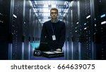 shot of server engineer pushing ... | Shutterstock . vector #664639075