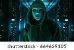 masked hacker in a hoodie...   Shutterstock . vector #664639105