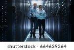 in data center two it engineers ...   Shutterstock . vector #664639264