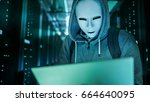 mid shot of a masked hacker in... | Shutterstock . vector #664640095