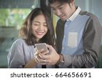 asian younger man and woman... | Shutterstock . vector #664656691