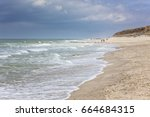 north sea beach of rotes kliff... | Shutterstock . vector #664684315