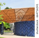 Small photo of LONDON - JUNE 21, 2017. Entrance to the 17th temporary Serpentine Gallery annual Summer Pavilion, designed this year by African architect Francis Kere, located in Kensington Gardens, London, UK.