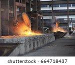pouring hot ferro silicon for... | Shutterstock . vector #664718437