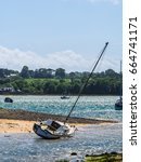 Small photo of Moored yacht half afloat