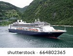 Small photo of GEIRANGERFJORD, NORWAY - June 7, 2017: ROTTERDAM of Holland America Line. Holland America Line was founded in 1893 and is a subsidiary of Carnival Corporation & plc since 1989.