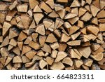 pile of old firewood for... | Shutterstock . vector #664823311